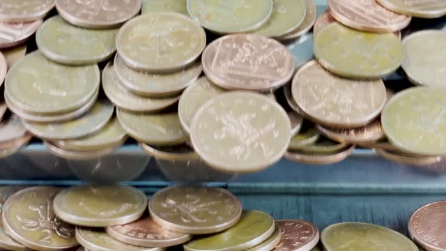 4k multiple angle compilation of 2 pence coin pusher at a seaside amusements arcade. very popular beach game played by locals and tourists on holiday / vacation. - 1 minute or greater stock videos & royalty-free footage