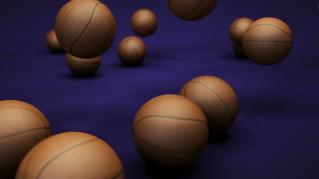 multiple basketballs are dropped to the ground. - auf und ab springen stock-videos und b-roll-filmmaterial