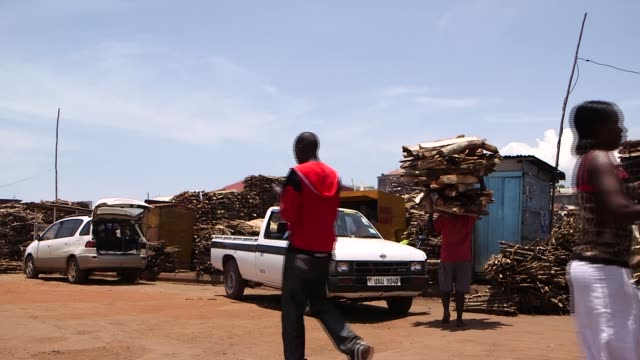 multiple clips. gaba is one of the largest markets and collections of fire wood. the wood is brought from the islands of lake victoria to gaba a... - kampala stock videos & royalty-free footage
