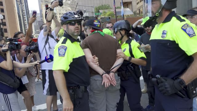 multiple counter anti-trump demonstrators arrested and pepper sprayed during 'straight pride parade' in boston, massachusetts. multiple arrested for... - omofobia video stock e b–roll