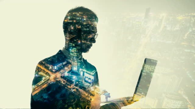 multiple exposure of businessman using laptop - composite image stock videos & royalty-free footage