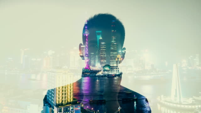 Multiple Exposure of businessman with city