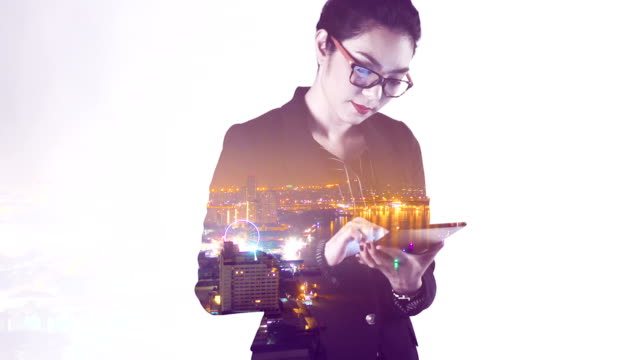 Multiple Exposure of businesswoman using tablet.