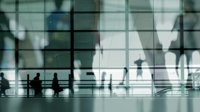 Multiple Exposure of people walking at airport