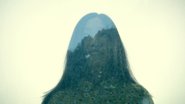multiple exposure of woman and mountain in snow - schöne natur stock-videos und b-roll-filmmaterial