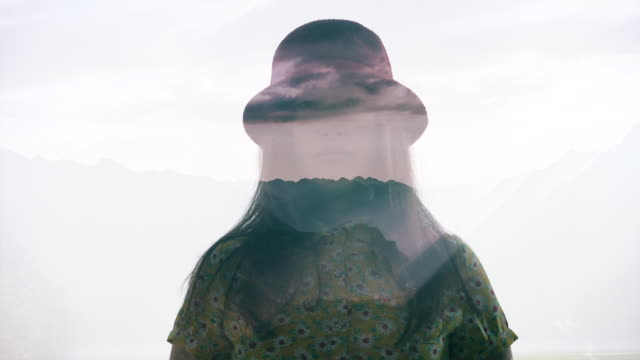 Multiple Exposure of woman in mountain