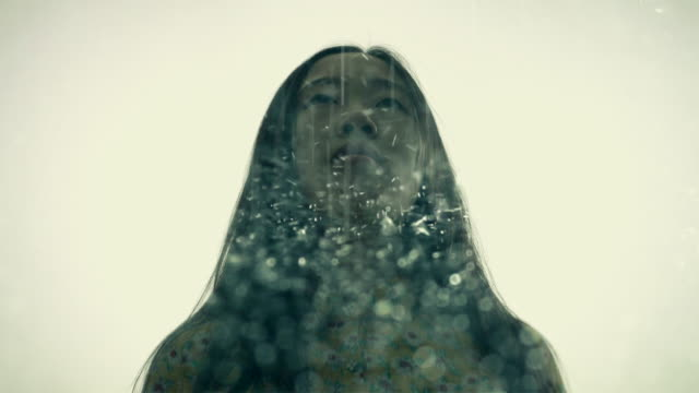 multiple exposure of woman in the rain - back lit woman stock videos & royalty-free footage