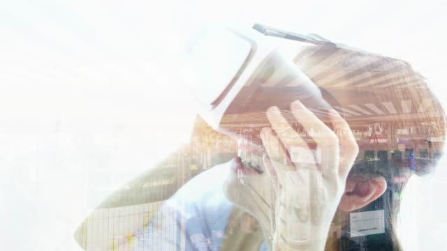 Multiple Exposure of young woman wearing virtual reality