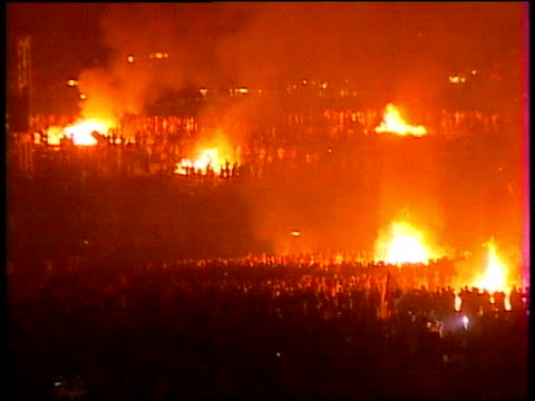 Multiple fires burning among the crowds at Woodstock 1999