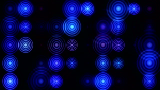 multiple glowing circular shapes on black background - fade out stock videos & royalty-free footage