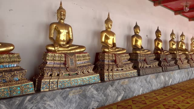 multiple golden buddha statues in wat pho temple or temple of the reclining buddha, bangkok thailand - buddha stock videos and b-roll footage