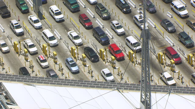 WS ZO AERIAL POV Multiple lanes of stopped traffic in Tijuana Mexico at international border crossing with San Diego / San Diego, California, United States
