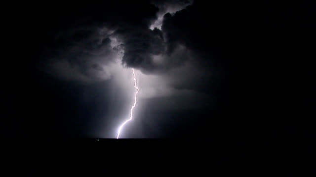 multiple lightning strikes at night - temporale video stock e b–roll