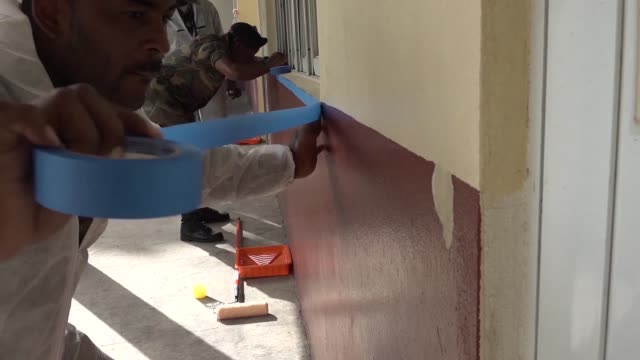 multiple nations helped communities of st kitts and nevis by painting and cleaning schools during exercise tradewinds. - paint roller stock videos & royalty-free footage