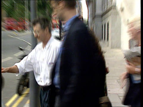 london old bailey julia mason shielded by man as along from court pan rl and into car pull - itv news at ten stock-videos und b-roll-filmmaterial
