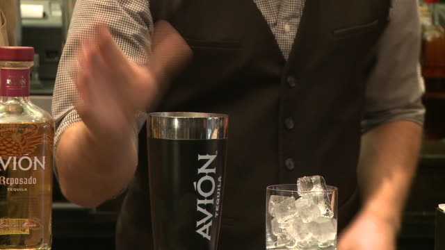 multiple shots, bartender mixing and pouring avion margarita - avion stock-videos und b-roll-filmmaterial