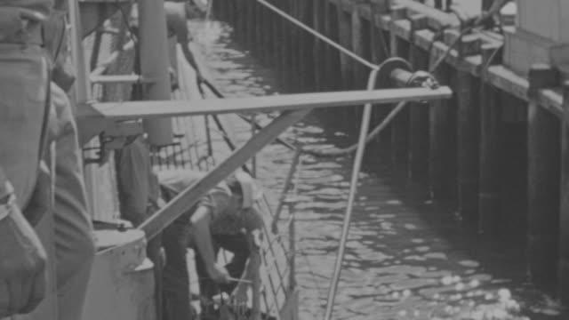 ms multiple shots of navy ship moving from dock  - 金管楽器点の映像素材/bロール