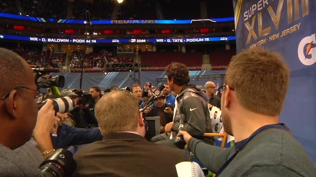 Multiple shots of Seattle Seahawks Quarterback Russell Wilson being interviewed at the Super Bowl Media Day at the Prudential Center in Newark New...