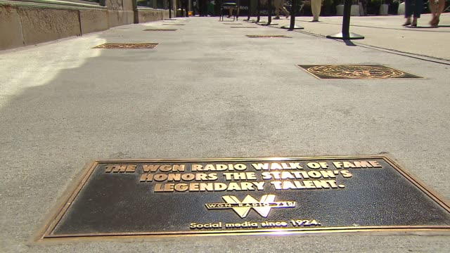 multiple shots of the exterior of wgn radio and it's walk of fame on michigan avenue in chicago on june 27, 2014. - torre del tribune video stock e b–roll