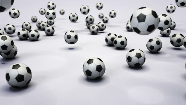 multiple soccer balls are dropped to the ground. - viele gegenstände stock-videos und b-roll-filmmaterial