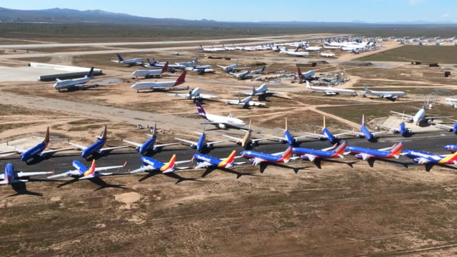 stockvideo's en b-roll-footage met multiple southwest jets parked on a runway at southern california logistics airport they are being stored there due to decrease in airline activity... - blijf staan