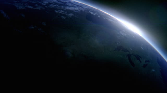 Multiple static - The sun appears over the Earth's horizon from space.