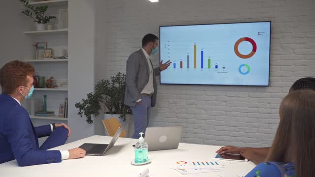 multiracial business team analysing their latest business figures on a board meeting - conference event stock videos & royalty-free footage