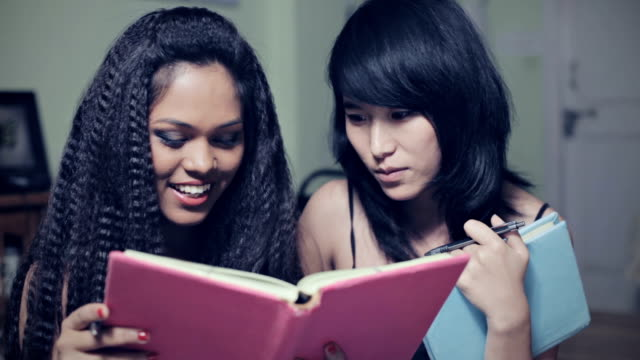 multiracial happy girl students together with book. - crimped hair stock videos and b-roll footage