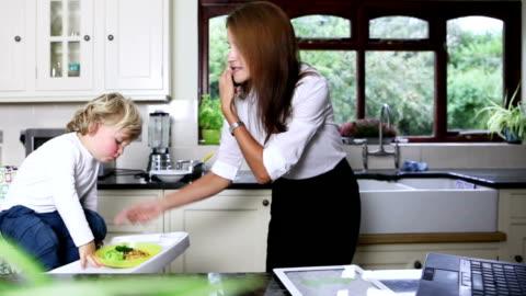 multitasking business mum homeworker - busy stock videos & royalty-free footage