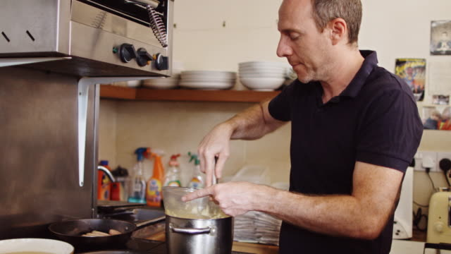 multi-tasking cafe owner - hollandaise sauce stock videos and b-roll footage