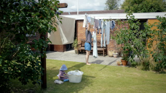 Mum and daghter doing laundry