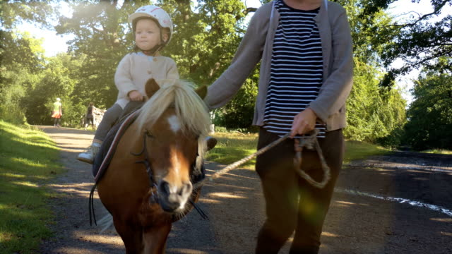 mum and daughter riding on pony - horseback riding stock videos & royalty-free footage