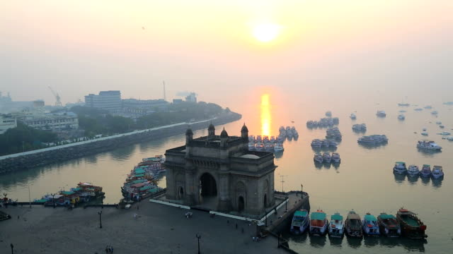 mumbai india gate maharashtra asia sunrise vessel  - colonial stock-videos und b-roll-filmmaterial