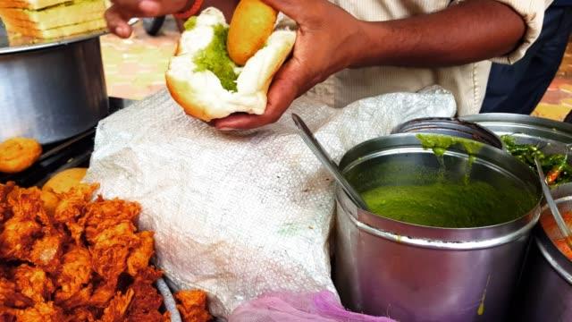 mumbai street food scene - vada pav street vendor - staple stock videos & royalty-free footage