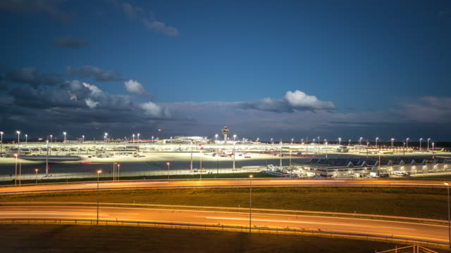 munich airport muc, timelapse, day to night transition - shot-1 - international air transport association video stock e b–roll