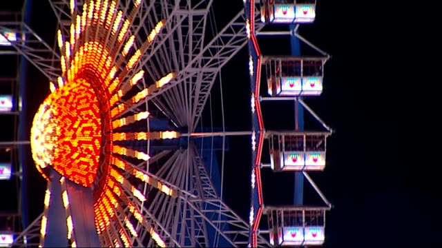 gvs of oktoberfest beer festival; night more gvs of freefall ride and ferris wheel various shots of festival goer passed out on the steps, lying next... - festival goer stock videos & royalty-free footage