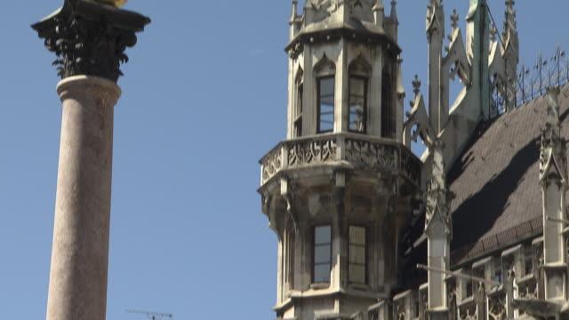 munich - marienplatz, city hall, figure in gold, blue sky, panning shot - female likeness stock videos & royalty-free footage