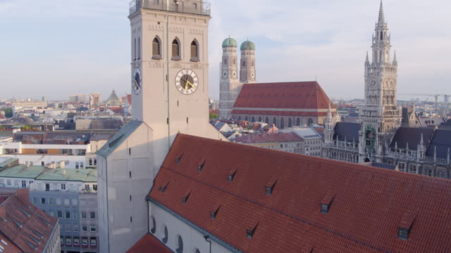 munich marienplatz rise from behind st_peter church to aerial overview of city - town hall stock videos & royalty-free footage