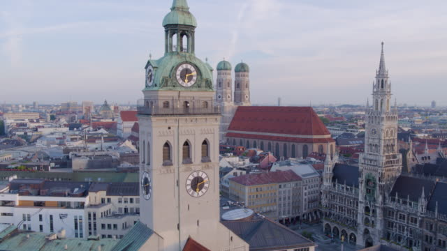 munich marienplatz rise from st_peter church roof to high altitude wide shot of new townhall - rathaus stock videos & royalty-free footage