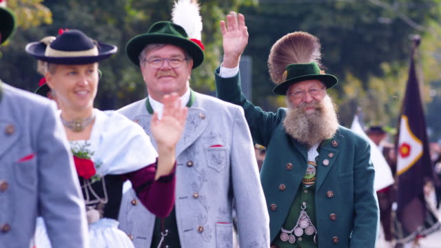 munich oktoberfest traditional costume parade man with huge beard waving at camera - traditional clothing stock videos & royalty-free footage
