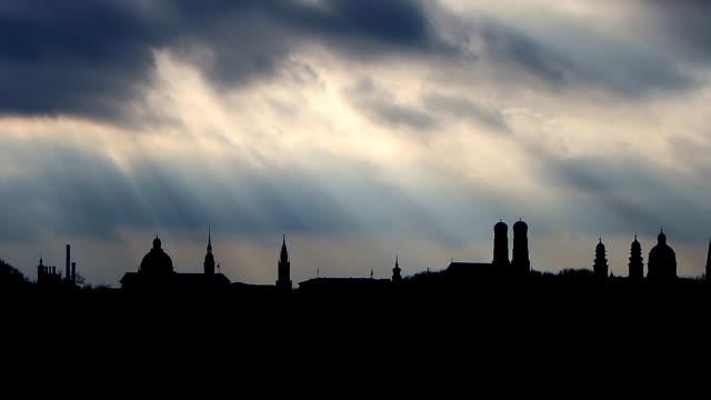 Munich skyline silhouette with stormy sky