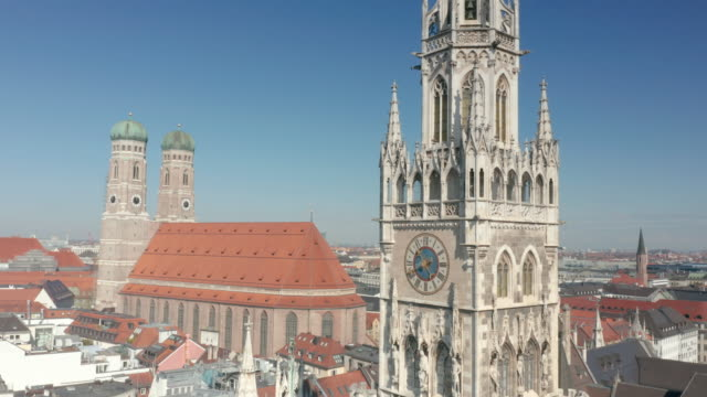 march 31. 2020: munich's city center with low pedestrian traffic due to the social distancing measures imposed by the government because of the... - kathedrale stock-videos und b-roll-filmmaterial