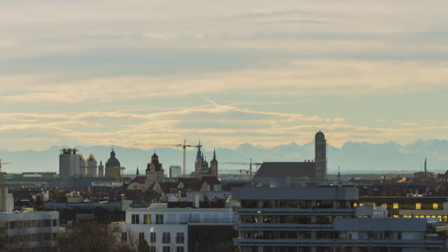 T/L Munich's skyline with the iconic Frauenkirche in front of the Bavarian Alps