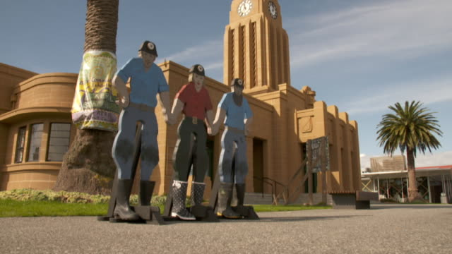 Municipal Chambers building in Westport with models of miners in front