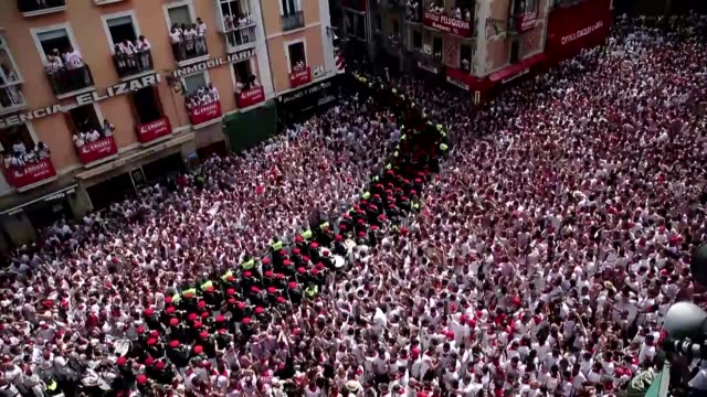 a municipal music band performs during the launch of the 'chupinazo' rocket to celebrate the official opening of the 2017 san fermin festival in... - comunidad foral de navarra stock videos and b-roll footage