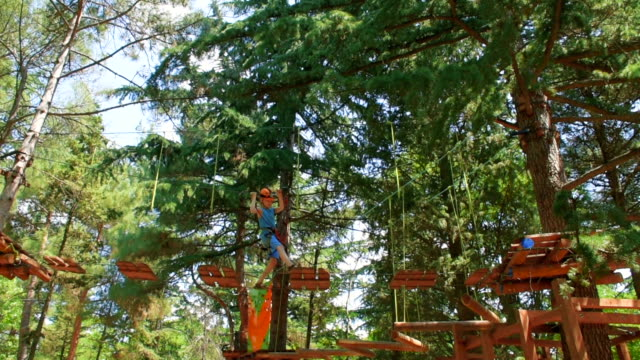 municipal park in summer, boy in the rope park