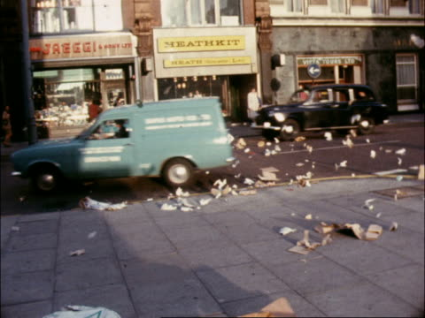 municipal strike in the west end in the west end an emergency squad of strikers have been clearing rubbish piled outside clubs and passageways... - council stock videos and b-roll footage