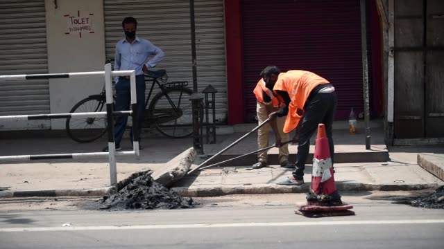 a municipal worker collecting garbage - india politics stock videos & royalty-free footage