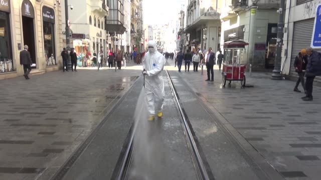 municipal workers work to disinfect the streets and public buildings, including mosques and churches, in istanbul's taksim square and istiklal street... - hygiene stock-videos und b-roll-filmmaterial