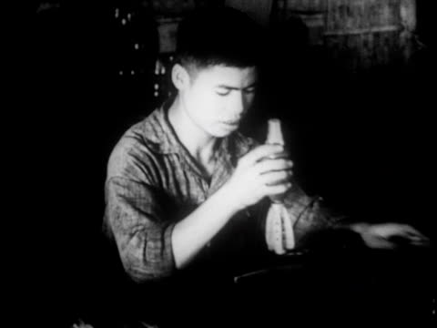 stockvideo's en b-roll-footage met a munitions factory set up in the jungle producing arms and ammunition for the war - strohoed